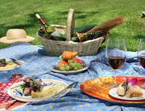 A picnic spread with cheese and wine