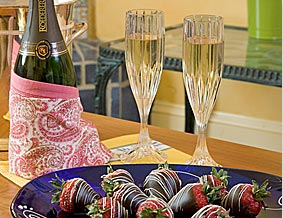 Chilled white wine served with chocolate covered strawberries