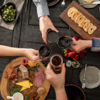 Friends celebrate over food and wine