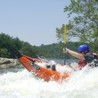 A kayaker braves the currents