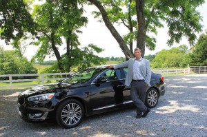 Sommelier Christian Borel stands next to his car