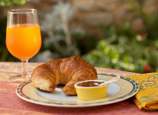 Breakfast croissant with orange juice