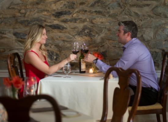 Couple enjoying fine dinner with wine