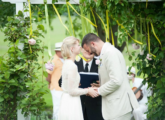Wedding couple laughing during ceremony