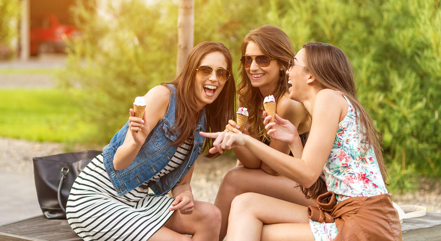 Women laughing and eating ice cream