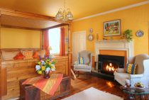 Chagall Room bed and sitting area with fireplace at our Virginia Wine Country bed and breakfast