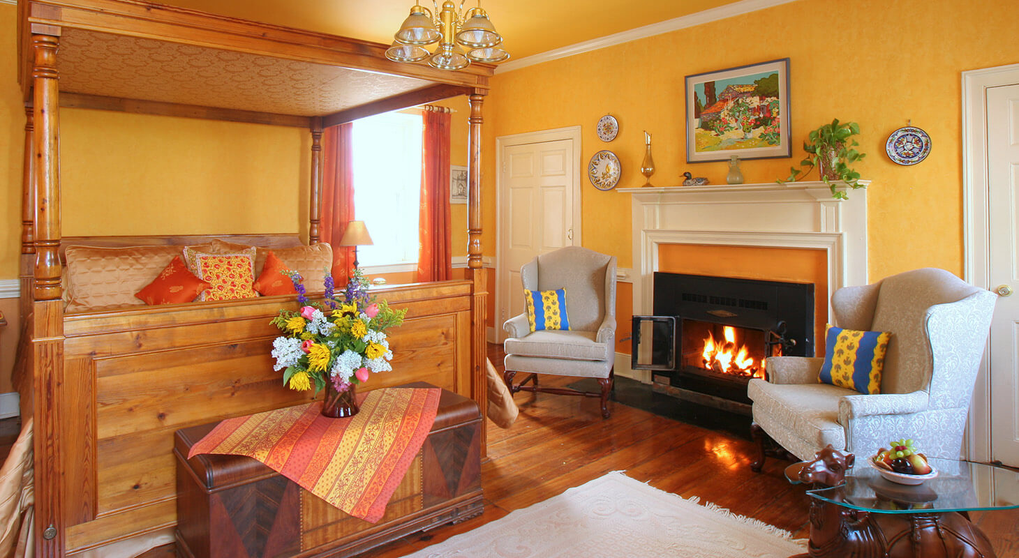 Chagall Room bed and sitting area with fireplace at our Virginia bed and breakfast