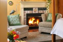 Coco Chanel Room seating area with fireplace at our Shenandoah Valley B&B