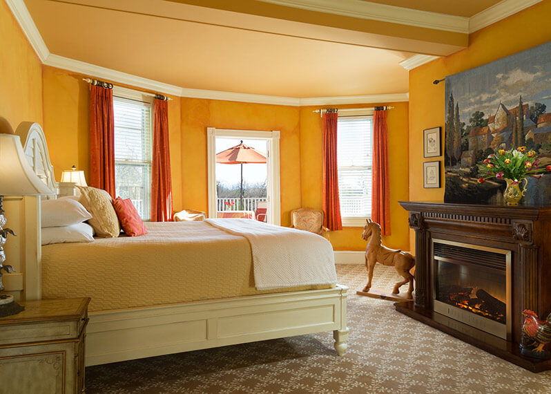 Lafayette Suite bed and fireplace at our Northern Virginia Wine Country Bed and Breakfast