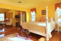 Louis XIV Suite bed and seating area at our Northern Virginia B&B
