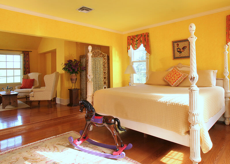 Louis XIV Suite bed and seating area at our Shenandoah Valley Bed and Breakfast
