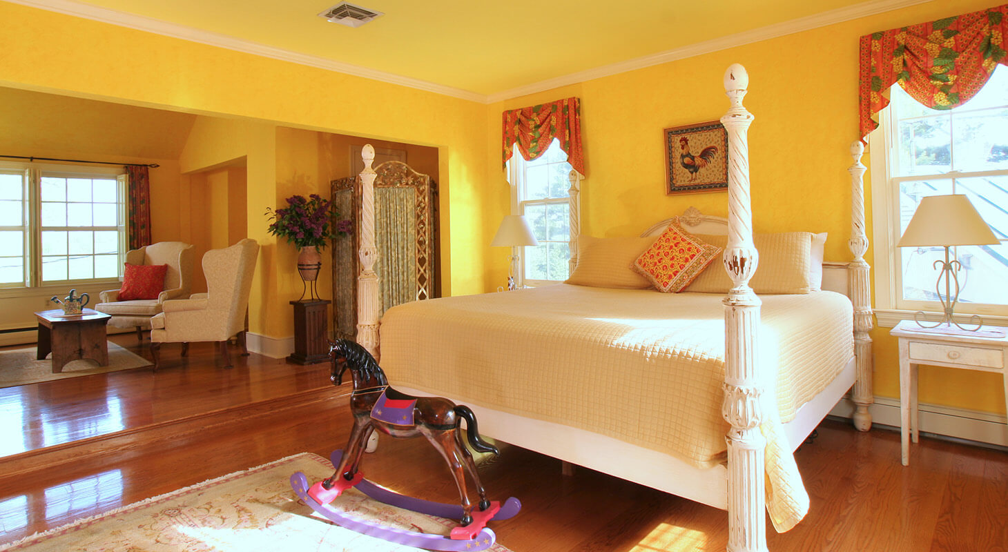 Louis XIV Suite bed and seating area at our Virginia bed and breakfast