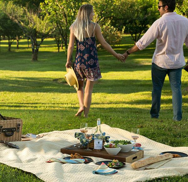 Couple holding hands and walking by a picnic at our Shenandoah Valley Bed and Breakfast