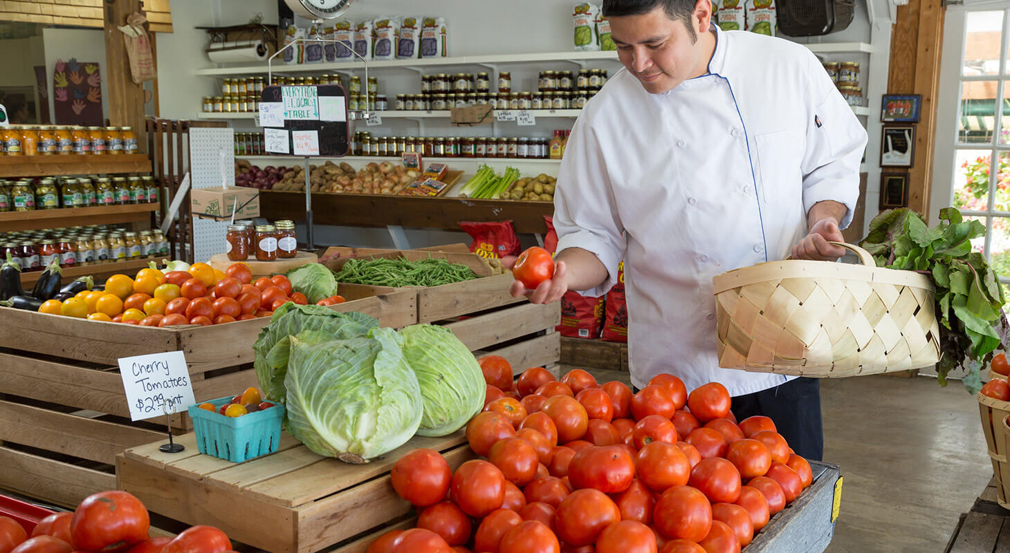 Chef shopping for locally grown produce at a store in Northern Virginia