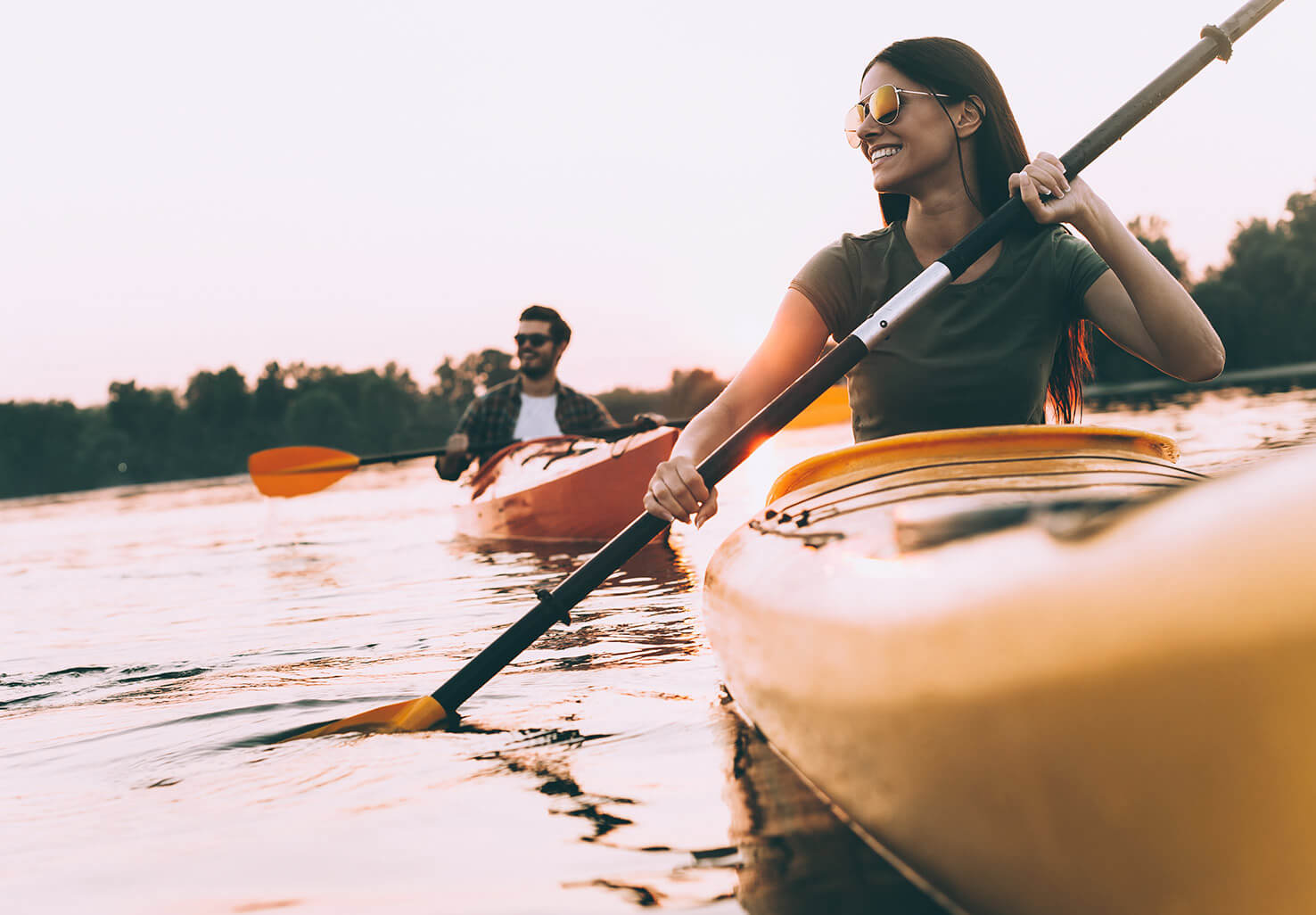 Couple kayaking on a river in Northern Virginia