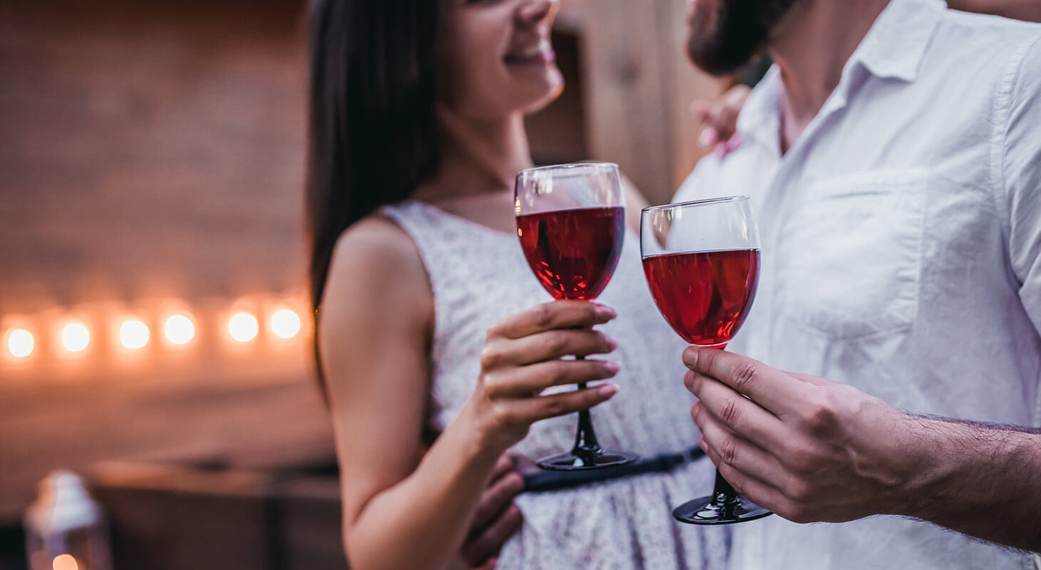 Couple holding wine glasses during a romantic getaway in Virginia