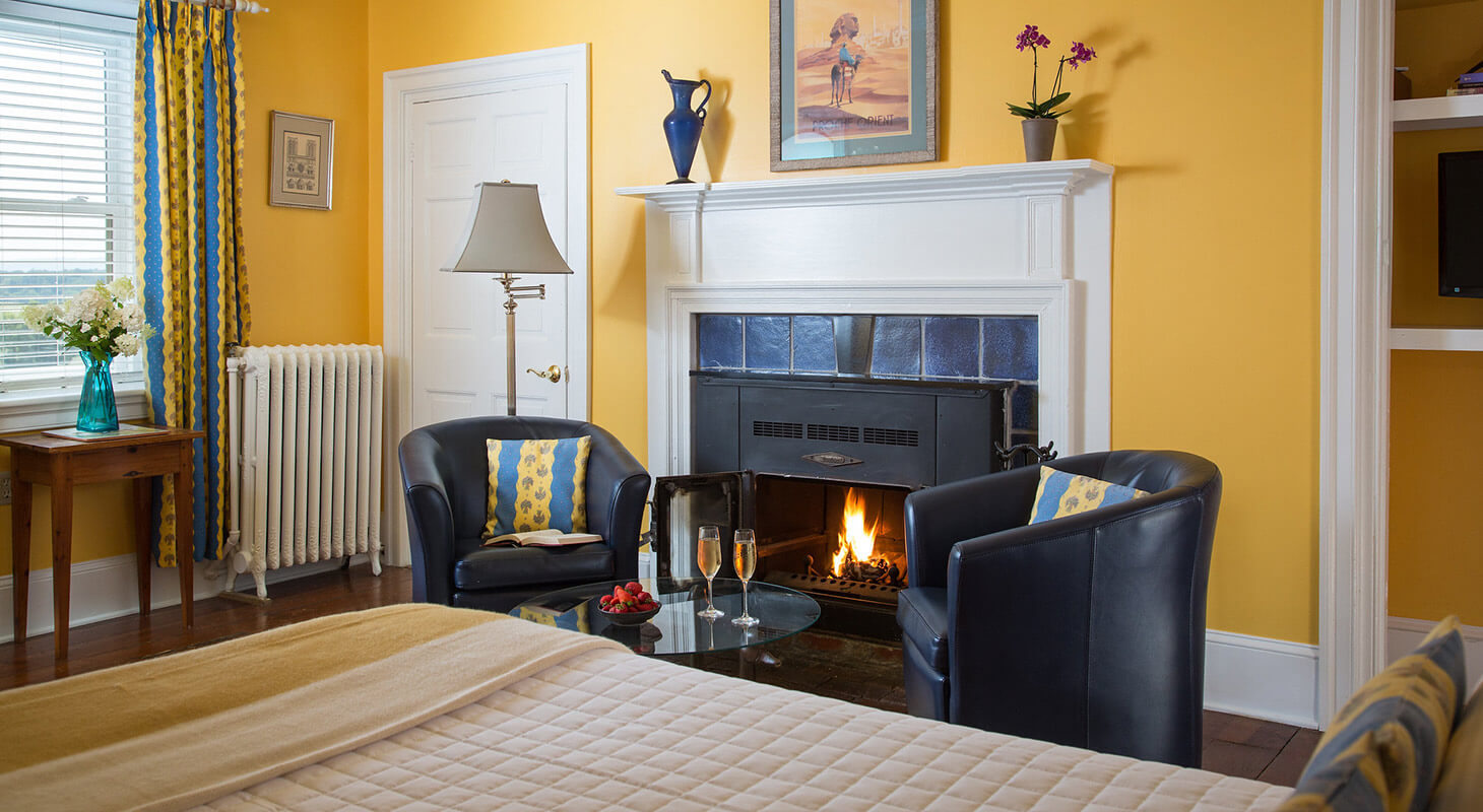 Monet room seating area with fireplace at our Shenandoah Valley B&B
