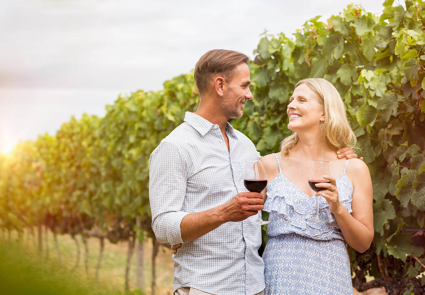 Happy couple with wine at a winery