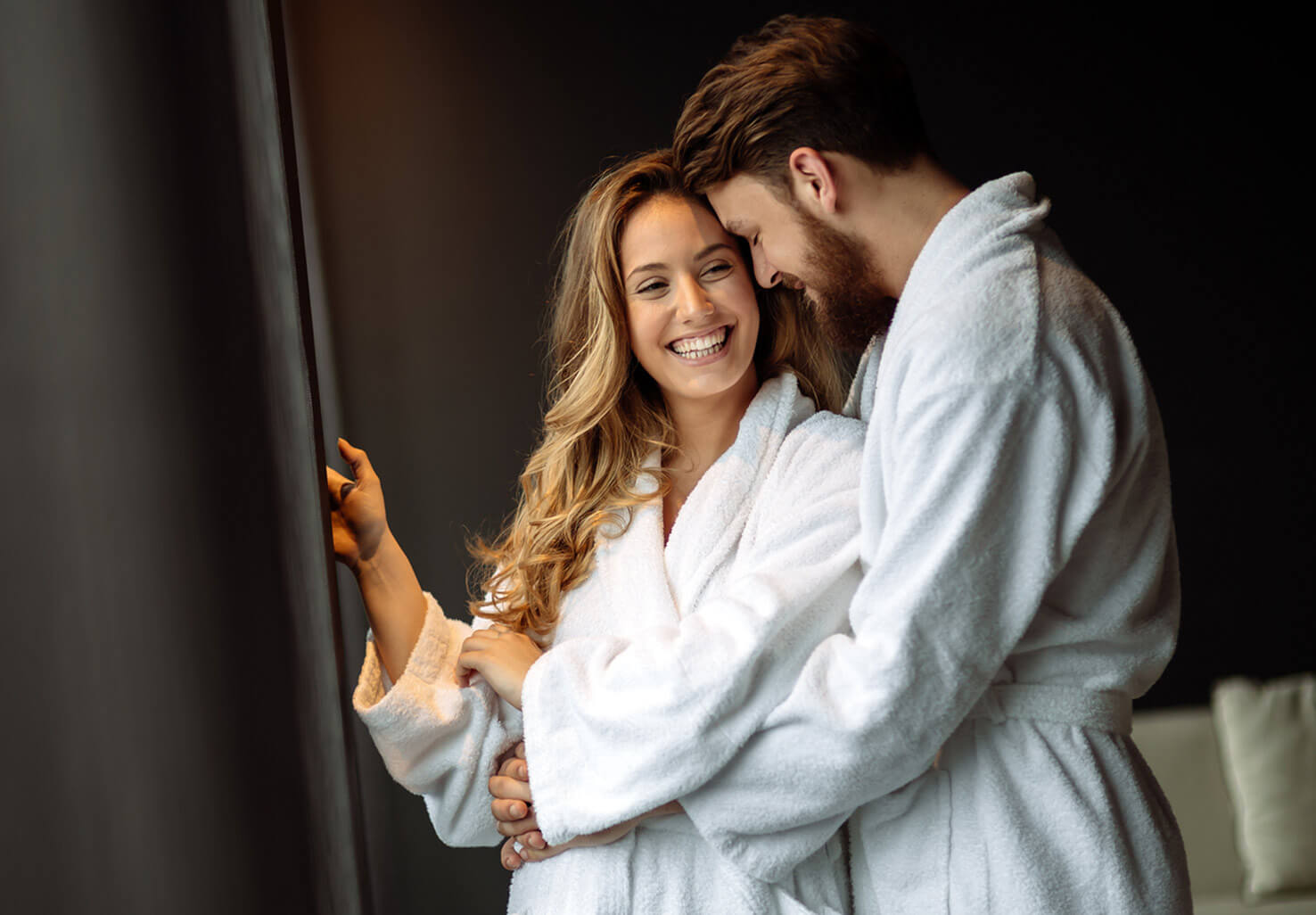 Romantic couple wearing cozy bath robes