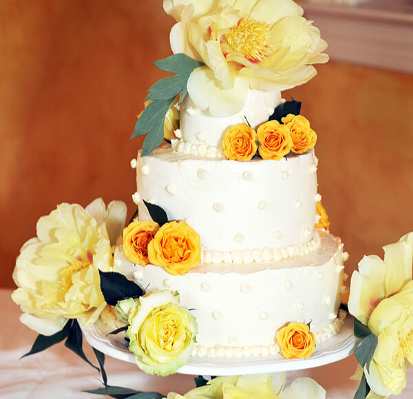 Three tier wedding cake with flowers at our Shenandoah Valley wedding venue