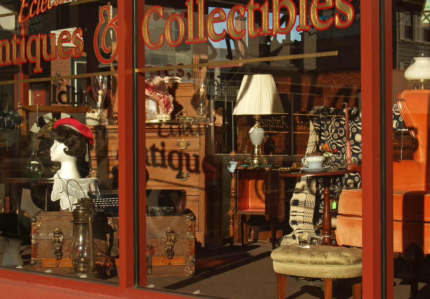 Antiques in the windows of an antique shop