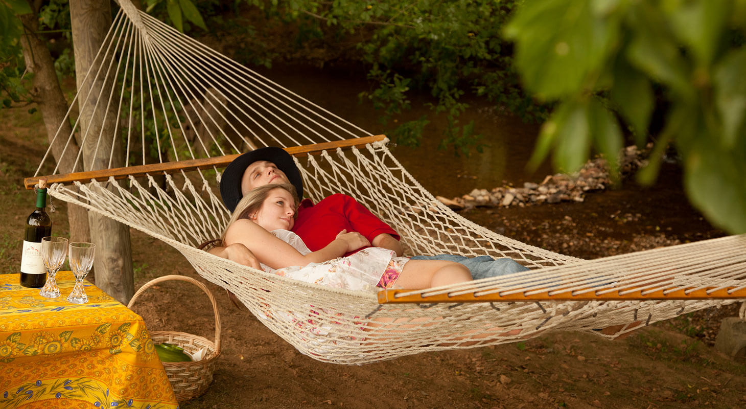 Couple in a hammock on our property in Northern Virginia