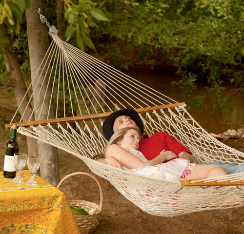 Couple in hammock at Lauberge Provencale