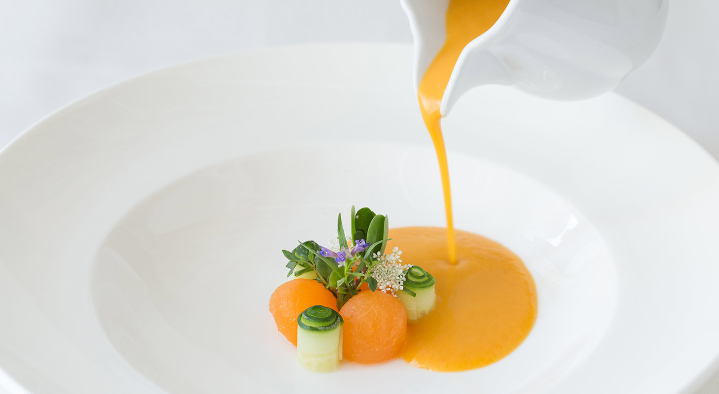 Melon Gazpacho Soup being poured at our Award-Winning Restaurant