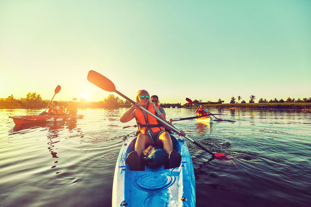 Family kayaking in Virginia at sunset