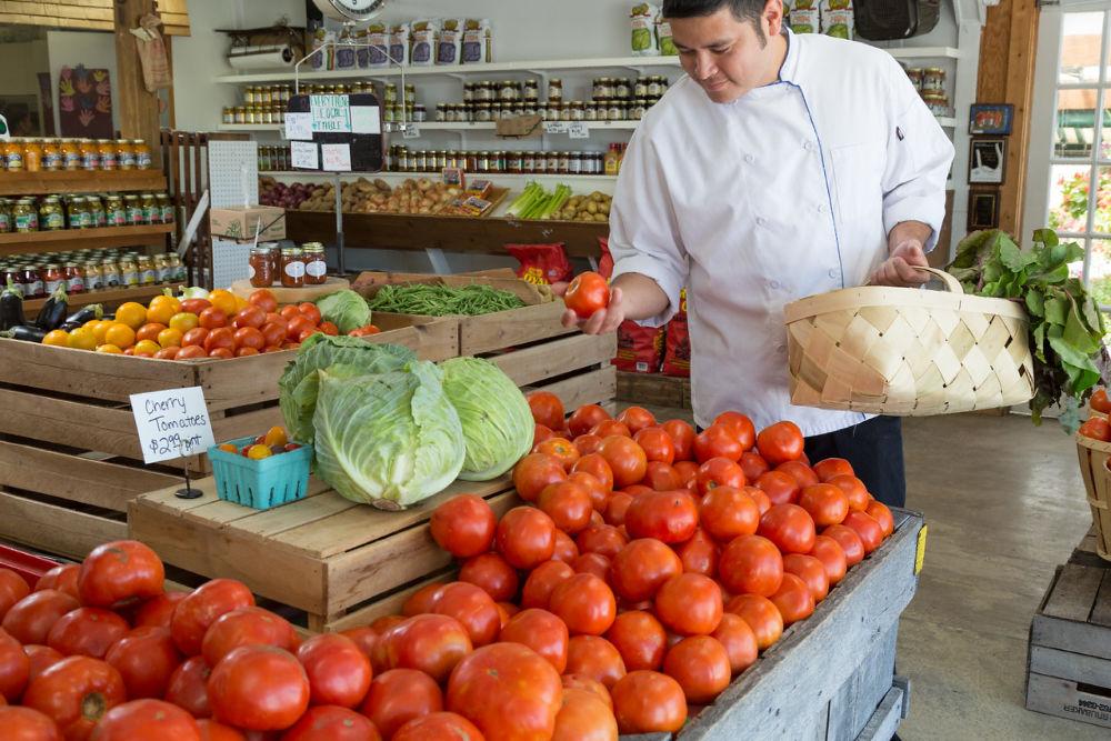 a chef browsing a farmer's market