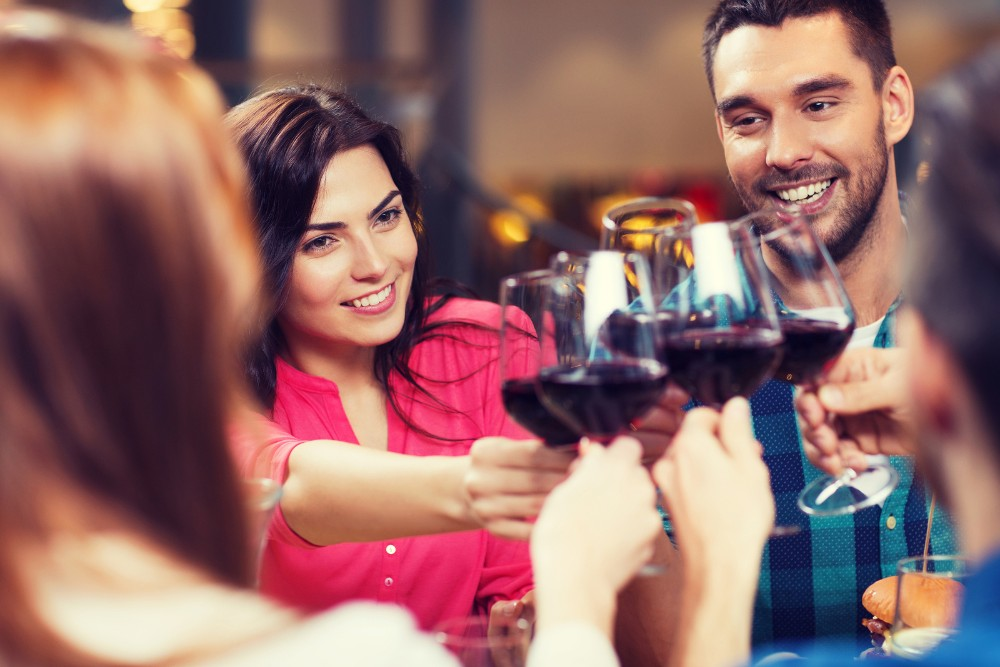 group of friends toasting with red wine