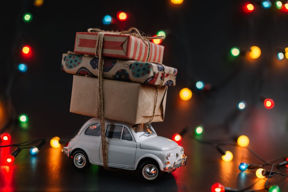toy car with Christmas gifts tied on top