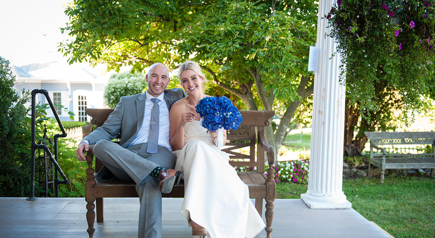 Bride and groom celebrating at L'Auberge wine country wedding venue