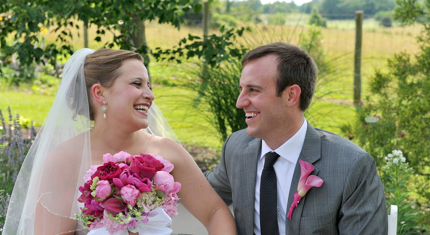 Bride and groom laughing at each other at Northern Virginia Wedding