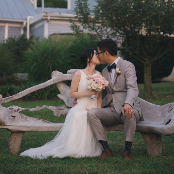 Asian couple kissing after L'Abuerge wedding