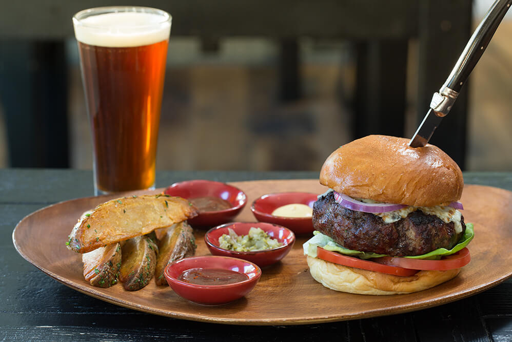 gourmet burger and a beer