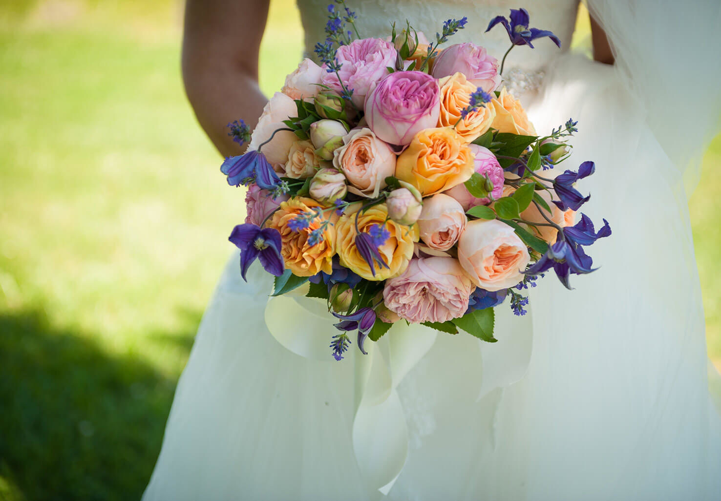 bride holding a colorful bouquet of flowers