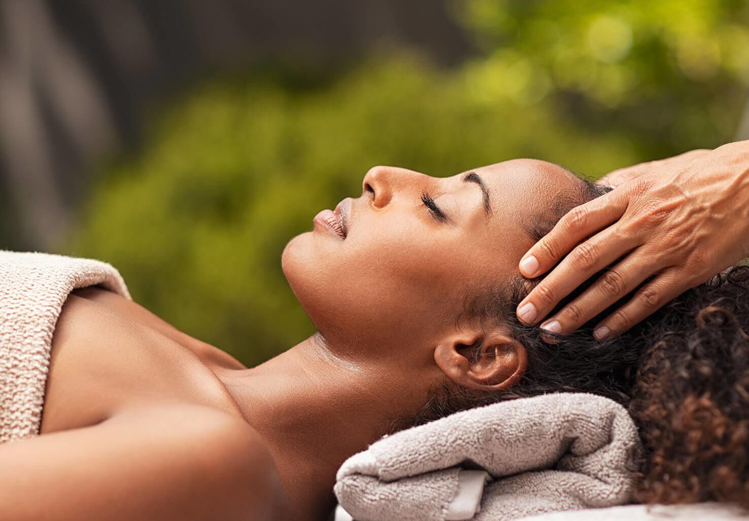 Woman getting a massage on romantic getaway in VA