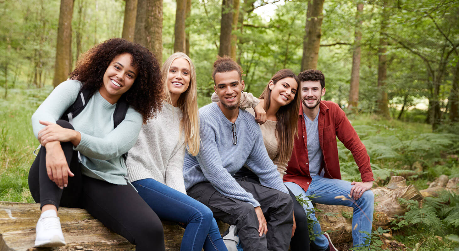 Friends on hike during group getaway in VA