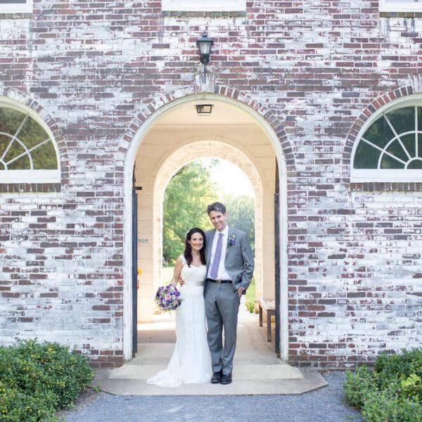 wedding couple under a stone arch doorway