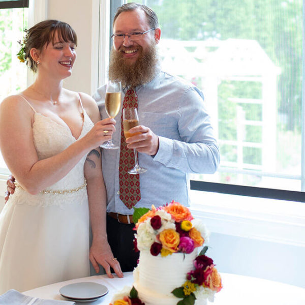 newlyweds toasting over their cake