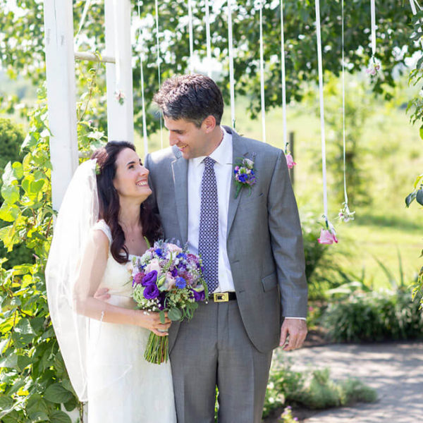 bride and groom smiling after their outdoor ceremony