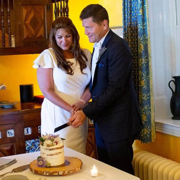 Newlyweds cutting their cake