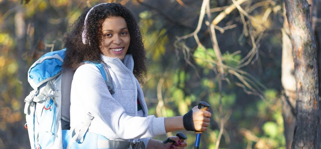 an african-american woman hiking in the forest