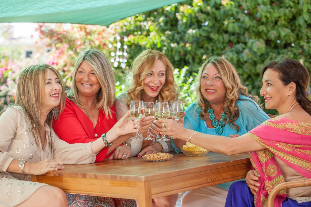 women outside with glasses of wine